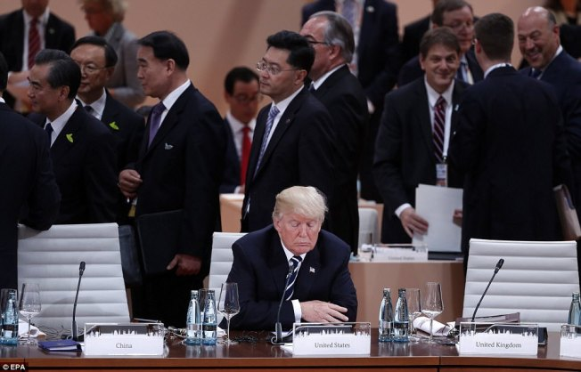 Trump sitting alone G20